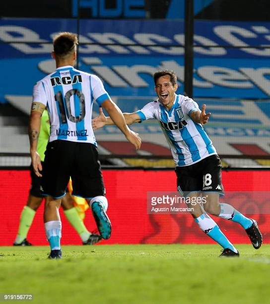 Augusto Solari of Racing Club celebrates with teammate Lautaro Martinez after scoring the rhitd goal of his team during a match between Racing Club...