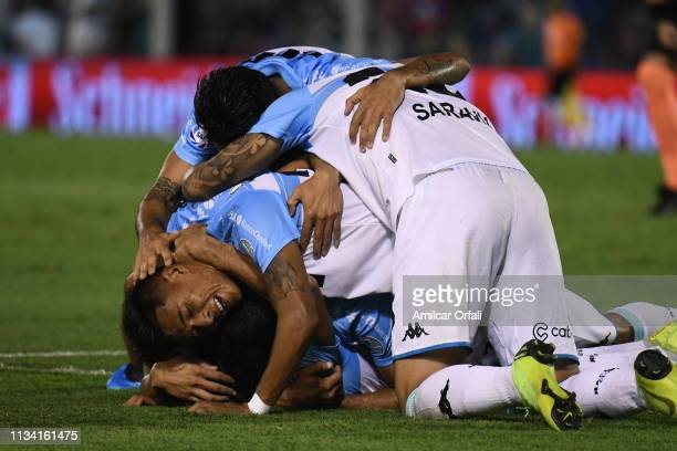 Augusto Solari of Racing Club celebrates with teammates after scoring the first goal of his team during a match between Tigre and Racing Club as part...