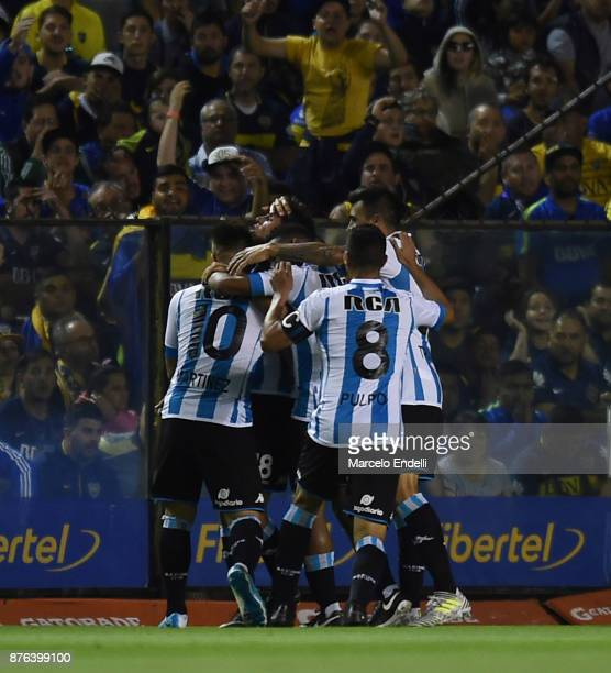 Augusto Solari of Racing Club celebrates with teammates after scoring the second goal of his team during a match between Boca Juniors and Racing Club...