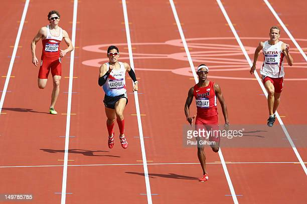 Augusto Stanley of Paraguay Yuzo Kanemaru of Japan Tony McQuay of the United States and Janis Leitis of Latvia compete in the Men's 400m Round 1...