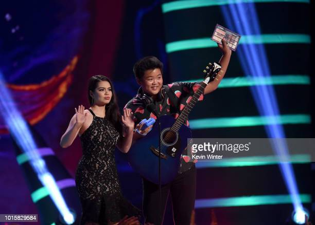 Auli'i Cravalho and Hudson Yang speak onstage during FOX's Teen Choice Awards at The Forum on August 12 2018 in Inglewood California