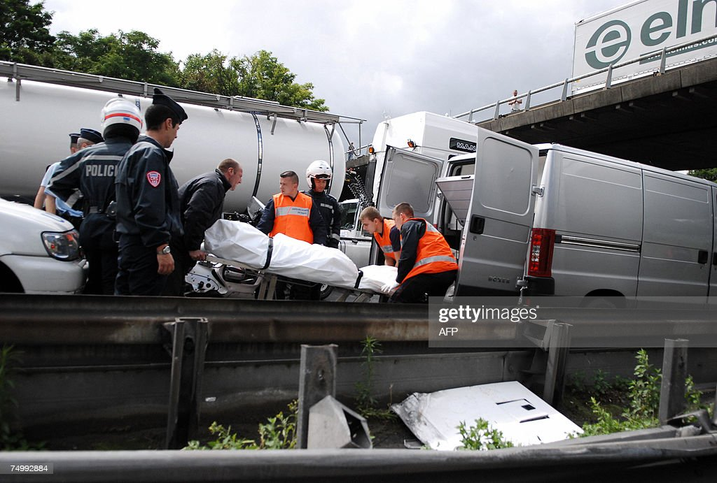 Rescuers remove the body of a truck driver who died in an