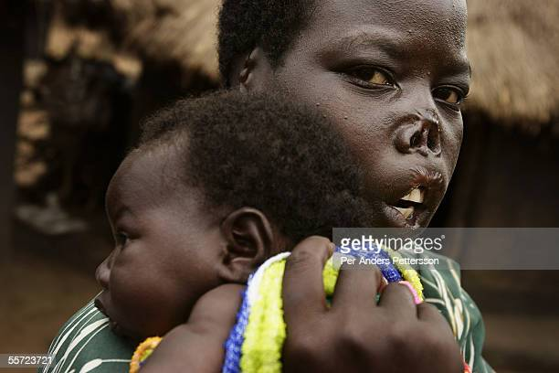 Auma Nancy age 18 holds her onemonth old baby girl Aloya Prsocovia on August 2 2005 in Paicho a camp for displaced people in Northern Uganda She was...