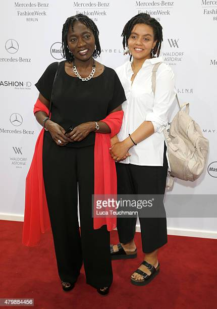 Auma Obama and Akini Obama attend the Minx by Eva Lutz show during the MercedesBenz Fashion Week Berlin Spring/Summer 2016 at Brandenburg Gate on...