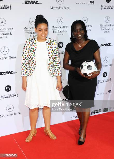 Auma Obama and daughter Akini arrive for the Minx By Eva Lux Show at MercedesBenz Fashion Week Spring/Summer 2013 on July 7 2012 in Berlin Germany