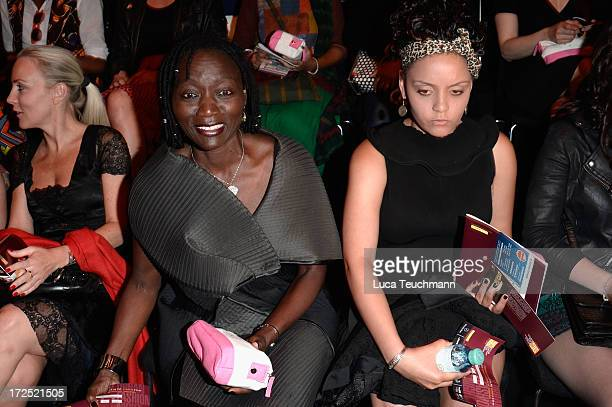 Auma Obama and daughter Akini attend the Arrey Kono Nadir Tati Romero Bryan Show during MercedesBenz Fashion Week Spring/Summer 2014 at Brandenburg...