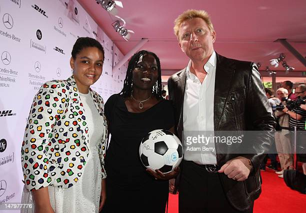 Auma Obama and daughter Akini meet Boris Becker ahead of the Minx By Eva Lux Show at MercedesBenz Fashion Week Spring/Summer 2013 on July 7 2012 in...