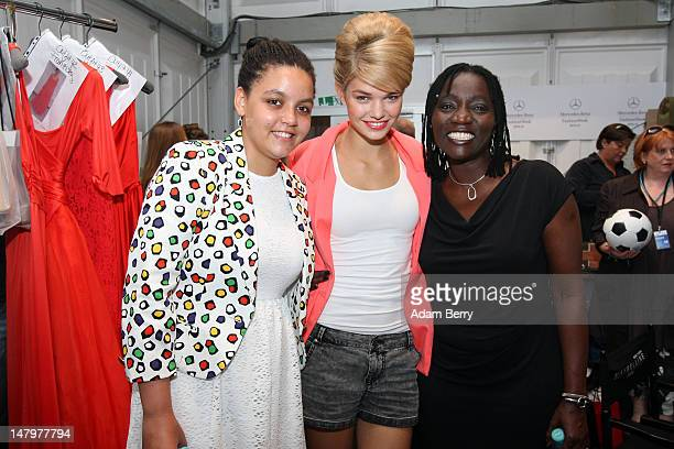 Auma Obama and daughter Akini pose with Luisa Hartema backstage ahead of the Minx By Eva Lux Show at MercedesBenz Fashion Week Spring/Summer 2013 on...