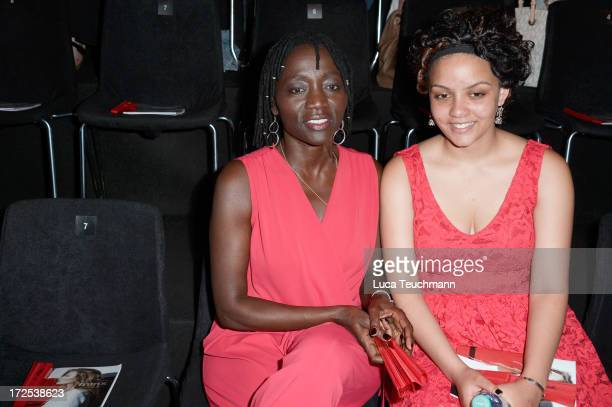 Auma Obama and her daughter Akini at the Minx By Eva Lutz Show during the MercedesBenz Fashion Week Spring/Summer 2014 at the Brandenburg Gate on...