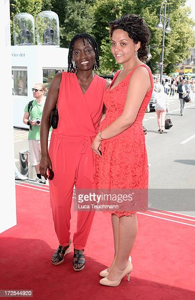 Auma Obama and her daughter Akini attend the Minx By Eva Lutz Show during the MercedesBenz Fashion Week Spring/Summer 2014 at the Brandenburg Gate on...