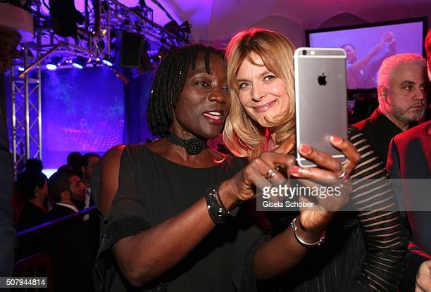 Auma Obama and Nastassja Kinski shoot a selfie during the Lambertz Monday Night 2016 at Alter Wartesaal on February 1 2016 in Cologne Germany