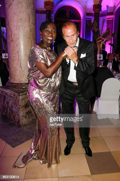 Auma Obama halfsister of former US president Barack Obama and German singer Michael Holm during the Minx Fashion Night in favour of 'Sauti Kuu' of...