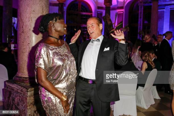 Auma Obama halfsister of former US president Barack Obama and German singer Michael Holm during the Minx Fashion Night in favour of 'Sauti Kuu' of...