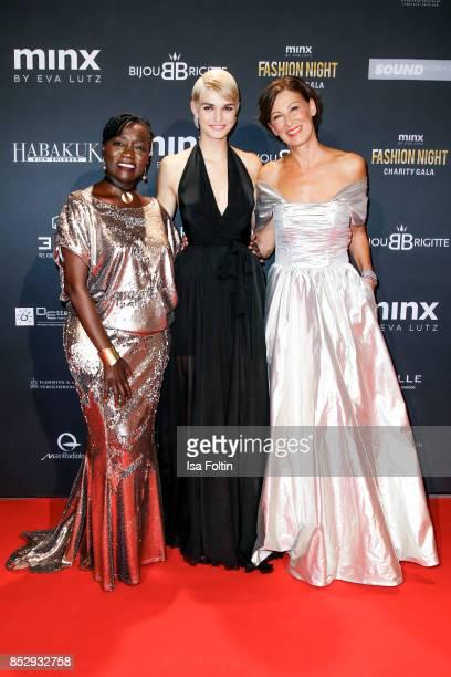 Auma Obama halfsister of former US president Barack Obama Model Luisa Hartema and Minx Designer Eva Lutz during the Minx Fashion Night in favour of...