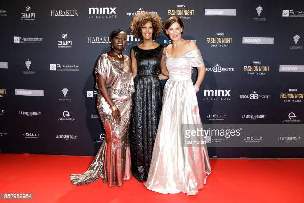 Auma Obama halfsister of former US president Barack Obama model Marie Amière and Minx Designer Eva Lutz during the Minx Fashion Night in favour of...