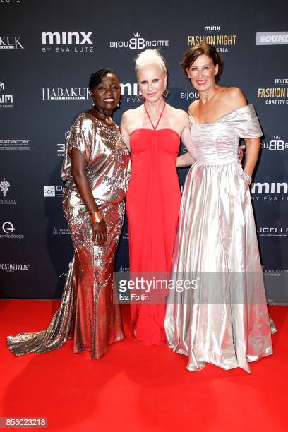Auma Obama halfsister of former US president Barack Obama Opera singer Nadja Michael and Minx Designer Nadja Michael during the Minx Fashion Night in...