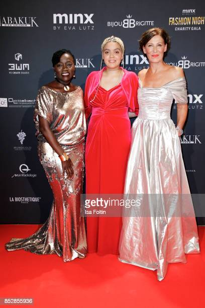 Auma Obama halfsister of the former US president Barack Obama with her daughter Akinyi Manners and Minx Designer Eva Lutz during the Minx Fashion...