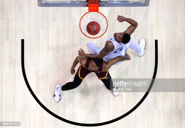Aundre Jackson of the Loyola Ramblers and Jordan Caroline of the Nevada Wolf Pack compete for a rebound in the first half during the 2018 NCAA Men's...
