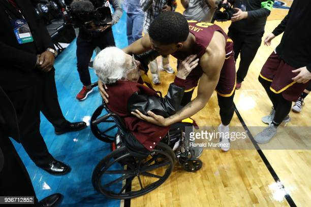 Aundre Jackson of the Loyola Ramblers celebrates with Sister Jean Dolores Schmidt after defeating the Nevada Wolf Pack during the 2018 NCAA Men's...