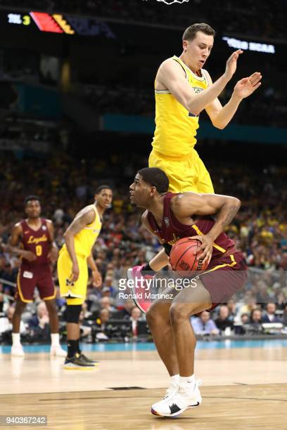 Aundre Jackson of the Loyola Ramblers is defended by Duncan Robinson of the Michigan Wolverines in the second half during the 2018 NCAA Men's Final...
