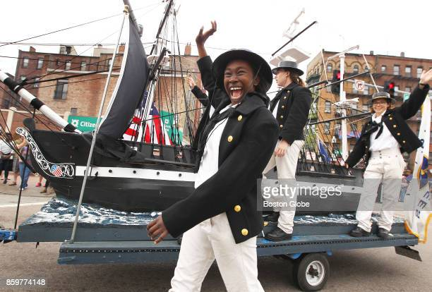Aundrea RobertsDavis a sailor assigned to the USS Constitution walks beside the float on Cross Street during the annual Columbus Day Parade in Boston...