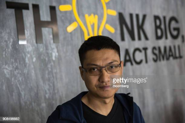 Aung Kyaw Moe founder and chief executive officer of 2C2P Pte poses for a photograph in Bangkok Thailand on Thursday Jan 18 2018 Aung is raising as...
