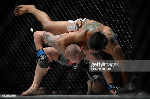 "Aung La N Sang from Myanmar known as ""Burmese Python"" fights Michal Pasternak from Poland during the One Championship mixed martial arts middleweight..."