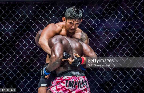 Aung La N Sang sets up his guillotine choke submission over Alain Ngalani during ONE Championship Hero's Dream at the Thuwunna Indoor Stadium on...
