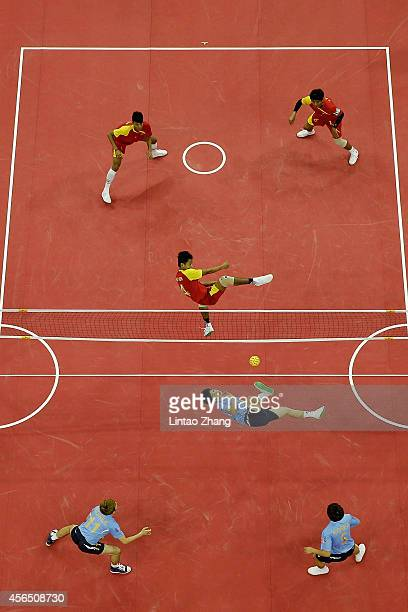 Aung Pyae Tun of Myanmar and Kim Youngman of South Korea compete for the ball in the Sepaktakraw Men's Regu Semifinal during day thirteen of the 2014...