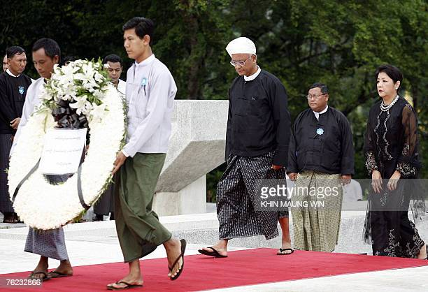 Aung San Oo elder brother of Myanmar's detained democracy leader Aung San Suu Kyi and his wife Lei Lei Nwe Thein arrives to pay respect to his father...