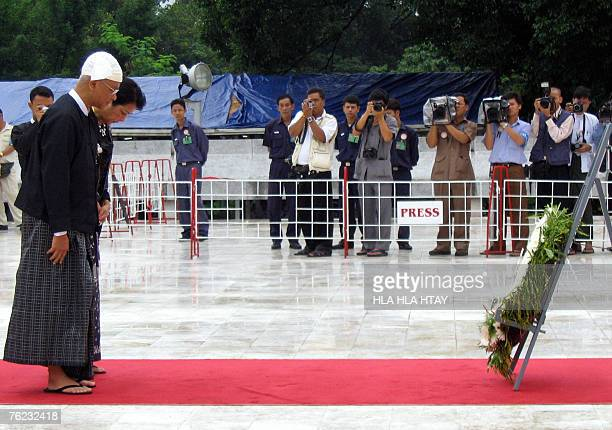 Aung San Oo elder brother of Myanmar's detained leader Aung San Suu Kyi along with his wife Lei Lei Nwe Thein pay respect to his father Myanmar's...
