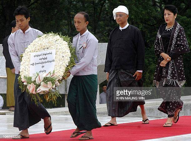 Aung San Oo elder brother of Myanmese detained leader Aung San Suu Kyi along with his wife Lei Lei Nwe Thein arrives to pay respect to their late...