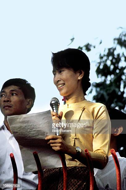 Aung san suu Kyi. A brave fighter for Democracy in Myanmar speaking to the public from her house.Unfortunately, 10 years after and she still can't...