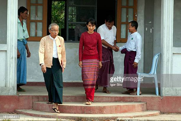 CONTENT] Aung San Suu Kyi arrives to visit a polling station in Kawhmu township April 1 where she is standing as a candidate in the parliamentary...