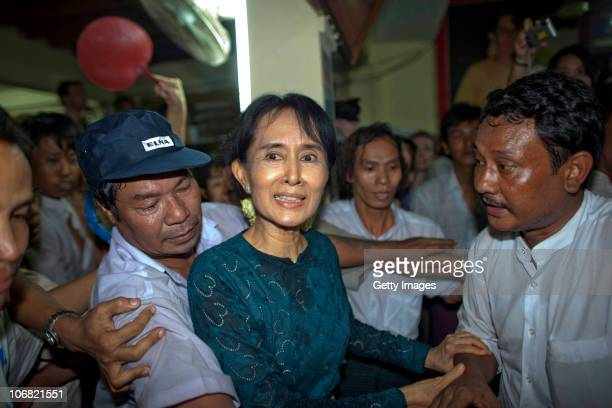 Aung San Suu Kyi leaves a press conference at her National League for Democracy headquarters on November 14 2010 in Yangon Burma Myanmar's...