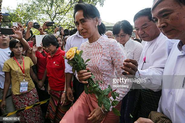 Aung San Suu Kyi Myanmar's opposition leader and chairperson of the National League for Democracy center arrives at the party headquarters in Yangon...