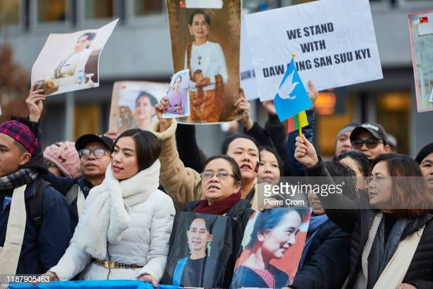 Aung San Suu Kyi supporters gather outside the Peace Palace in The Hague as Myanmar State Counsellor Aung San Suu Kyi leads its delegation to the...