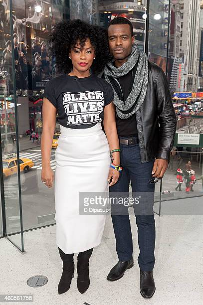Aunjanue Ellis and Lyriq Bent visit 'Extra' at their New York studios at H&M in Times Square on December 16, 2014 in New York City.