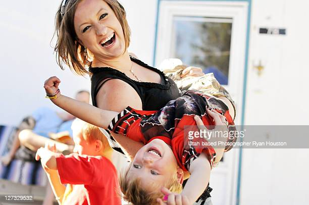 aunt and nephew spinning in front yard - aunt stock pictures, royalty-free photos & images