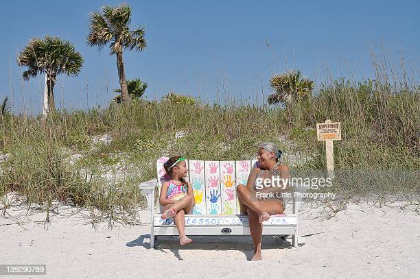 Aunt and niece wearing bathing suits at beach