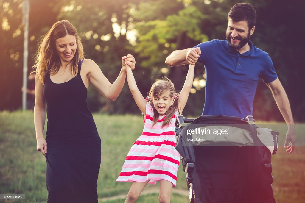 Aunt and uncle having fun with their niece in nature : Foto de stock