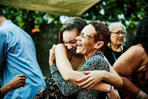 Aunt embracing niece after outdoor family dinner party - gettyimageskorea