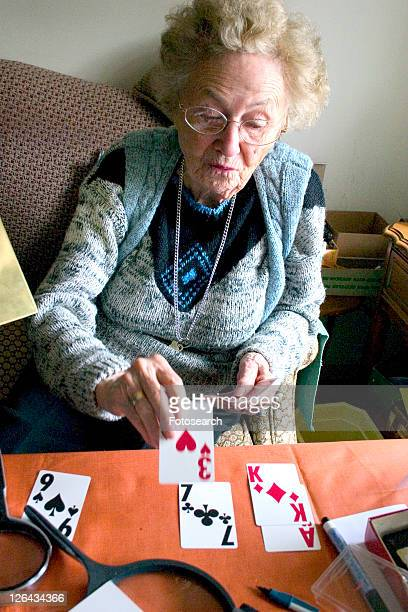 Aunt Fran age 92 playing solitaire with large print cards suffering from macular degeneration