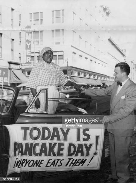 Aunt Jemima is greeted at the Post Tuesday by Jack Michel of The Post advertising department Aunt Jemima representing the famous pancake mix...