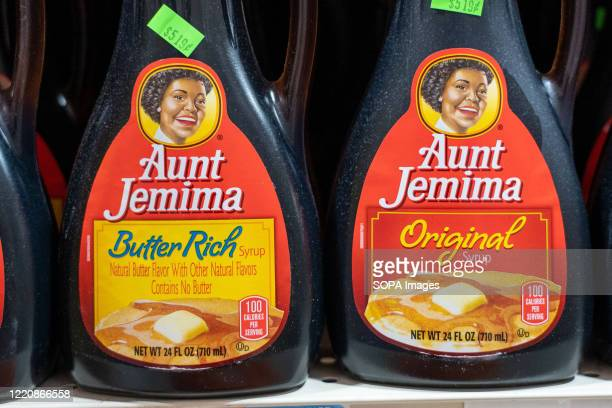 Aunt Jemima products seen displayed on supermarket shelves. After decisions by Aunt Jemima and Uncle Bens to overhaul their imaging in the wake of...