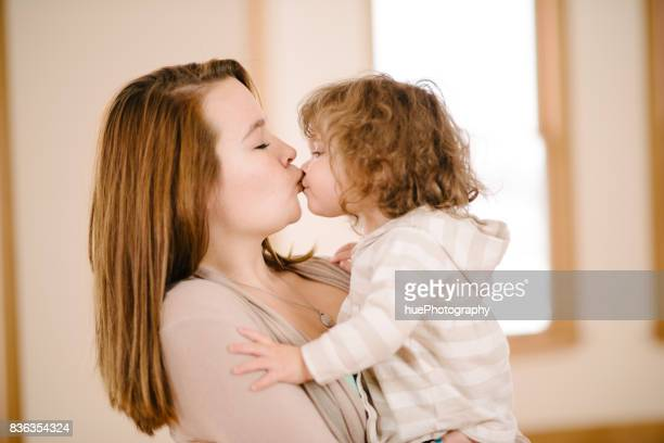 aunt kissing niece - niece stock photos and pictures