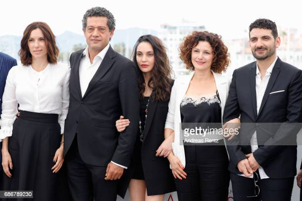 Aure Atika Hassan Kachach Hania Amar Nadia Kaci and director Karim Moussaoui attend 'Waiting For Swallows ' photocall during the 70th annual Cannes...