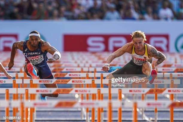 Aurel Manga of France and Gregor Traber of Germany during 110 meter hurdles semifinal for men at the Olympic Stadium in Berlin at the European...