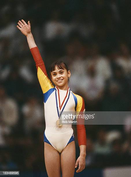 Aurelia Dobre of Romania salutes her gold medal after winning the Women's Balance beam event on 21st October 1987 during the World Artistic...