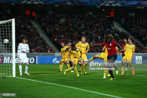 Aurelien Chedjou of Lille heads and scores his teams first goal of the game during the Group F UEFA Champions League match between LOSC Lille...